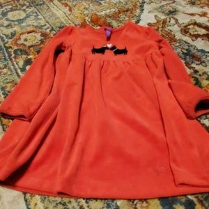 Very soft velvety red dress with two dogs on it. N